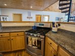 Full kitchen with stainless appliances and all the cookware you need