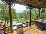 Hot tub and gas grill overlooking river, large open gathering areas around house