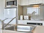 Appliances include full oven, ceramic cook top, rangehood, fridge/freezer, microwave,  waste master