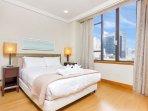 Sunny queen bedroom.