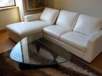 New leather chaise couch in living area