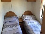 Twin bedroom 2 with two single beds