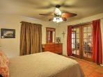 The master bedroom is located off of the living room on the first floor.