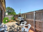 Step outside to relax on the fenced-in back patio!