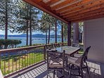 Patio furniture on the back deck overlooking the lake