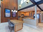 Granite dining table and breakfast bar next to the kitchen