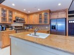 Kitchen with granite countertops and stainless steel amenities