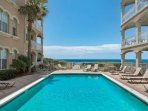 Enjoy swimming and laying out poolside - You are only steps away from both the pool area and sugar sand beaches at...