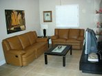Living room or second family room with TV.
