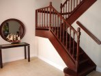 Entrance and beautiful wood stained stairs to second floor.