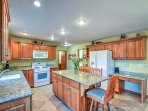The expansive granite counter tops offer all the space you need to prepare delicious home-cooked meals.