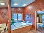 Relax in a bubble bath in this large en suite bathroom.