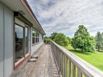 You'll love spending your time on the large wrap-around deck soaking in the fresh air and enjoying the vibrant green ...
