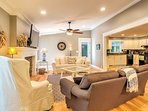 The well-appointed living space offers an open floor layout that combines the living room, dining area and kitchen.