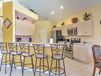 A large breakfast bar offers seating for 5 guests, great for a casual breakfast or snack before dinner.