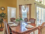 Gather around the elegant dining room table, which seats 6 guests.