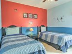 The themed children's rooms are decorated with princess and Mickey Mouse accents.