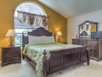 This king bedroom includes a crib for those traveling with young ones.