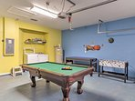 The property includes in-unit laundry machines, a pool table, foosball, and ping pong tables in the garage.