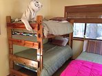 Kid's Bedroom with 2 Bunk Beds and a standard Double bed.