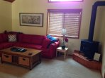 TV-Game Room with queen-size sofabed and propane stove