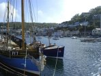 Nearby Looe, a lively seaside town with a beautiful harbour