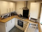 Newly Fitted Kitchen, well equipped with m/wave, washer dryer and fridge with ice box.