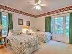 Drift off to sleep in this bedroom with 2 twin beds.