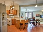 An open-concept layout makes it easy for those in the kitchen to converse with those in the living room.
