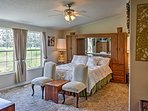 The beautiful master bedroom boasts a queen bed and beautiful views.