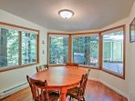 The dining area features a round table with seating for 4 guests.