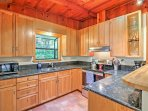 Cook up your favorite dishes in this well-equipped kitchen with updated stainless steel appliances.