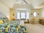Vaulted ceilings add extra depth to the space.