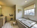 An en-suite bathroom features an oversized Jacuzzi tub.
