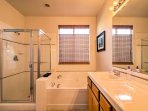 Decompress with a hot shower in this full en suite bathroom.
