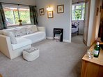 THE NEWLY DESIGNED SPACIOUS OPEN PLAN LIVING ROOM HAS LOVELY VIEWS OVER THE VALLEY OF PORTREATH