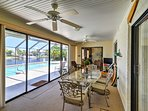 The screened-in patio offers a dining table for 6, flat-screen Satellite TV, and views of the private pool and the...