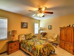 Enjoy restful nights of sleep in this spacious bedroom that features a twin bed and trundle.