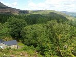 The Boathouse is set in woods, high above the Vale of ffestiniog