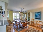 Have a seat at the dining table or the kitchen bar to enjoy home-cooked meals.
