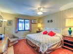 The master bedroom features a plush king bed and a flat-screen cable TV with Roku.