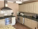 Fully fitted kitchen with washing machine and dishwasher
