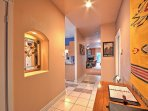 Inside, the home features tiled floors, carpet, an open layout and appealing decor.