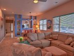 Gather around in the inviting living room and sink into the comfortable furniture and relax while you visit with your...