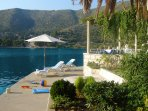Our private waterfront with sun beds and umbrellas which you can use at no additional cost