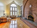 The dramatic brick fireplace adds to the character of this lovely home.