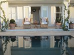 French doors from kitchen onto patio and pool