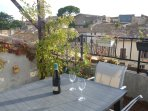Sunny terrace with views over the village and chateau. Enjoy a relaxing dinner & watch the sunset.