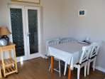 The dining area is conveniently located by the kitchen