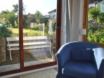Opening onto the garden, the lounge has a lovely outlook